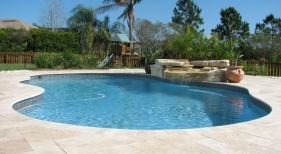 Freeform Pool with Waterfall and Travertine